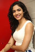 Actress Ritu Varma Stills in White Floral Short Dress at Kesava Movie Success Meet .COM 0118.JPG
