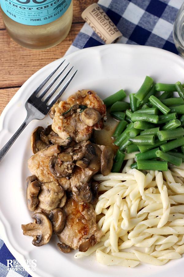 Easy Pork Tenderloin Marsala plated with wine