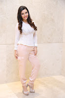 Kyra Dutt in Tight White Top Trousers at Paisa Vasool audio success meet ~  Exclusive Celebrities Galleries 038.JPG