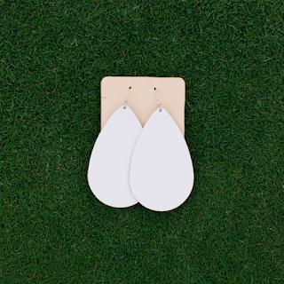 http://www.nickelandsuede.com/shop/team-white-leather-earrings