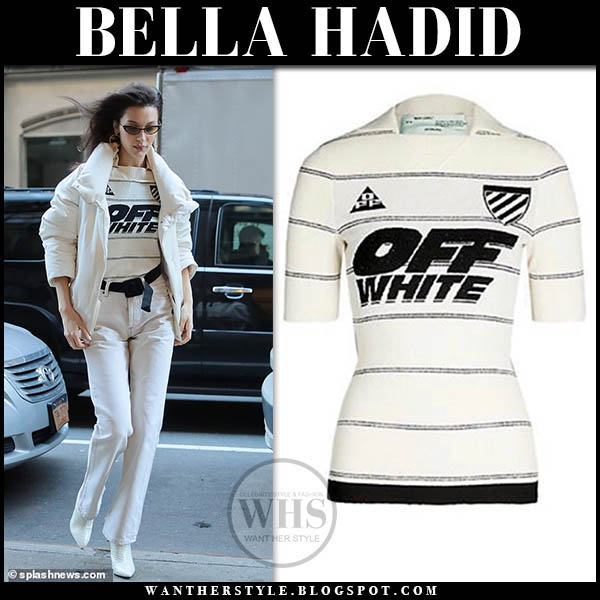 Bella Hadid wears white jacket, white stirped top, white jeans and white ankle boots fashion week model outfits february 2019