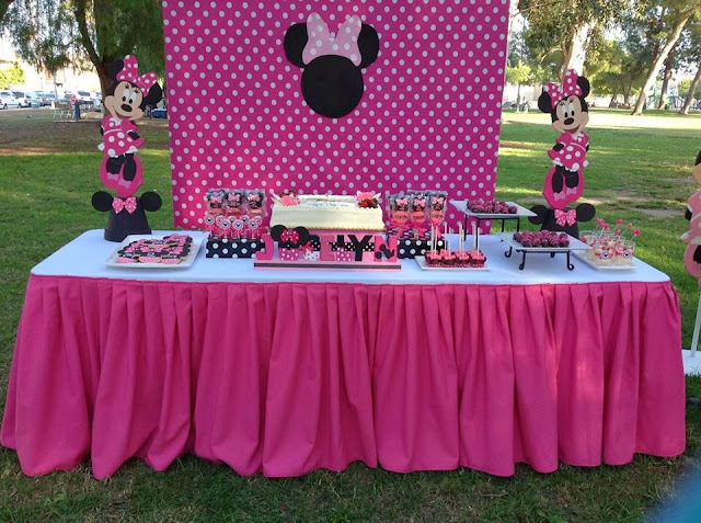 pink minnie mouse dessert table with props and backgrounds