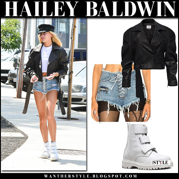 Hailey Baldwin in leather jacket and denim lace up shorts unravel and white leather boots august 25 2017