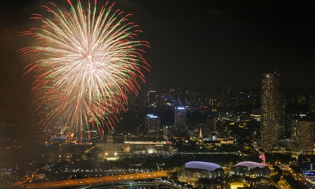 Fireworks light up the sky at Marina Bay in Singapore.