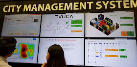 The DVUCA city management system dashboard features data from Singapore and other cities for quick comparisons of usage of water and power; and can even go micro to show if a person is at their desk.