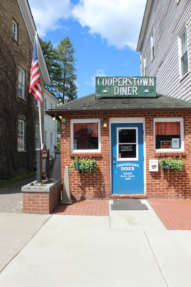 This Cooperstown Diner in the heart of the town is quaint and cute with a blue door.