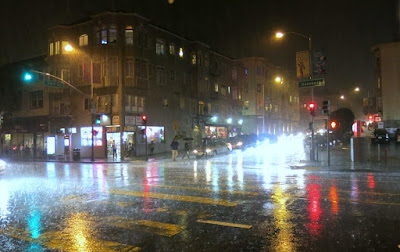 San Francisco: 7 p.m. on a rainy Wednesday evening. El Niño strikes at the intersection of Valencia and 24th streets. Photo by Gerard Koskovich.
