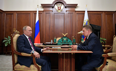Vladimir Putin and Gazprom CEO Alexei Miller in the Kremlin.