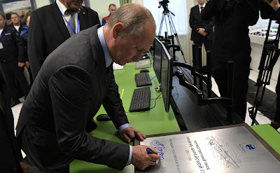 Vladimir Putin during his visit to Nizhne-Bureiskaya Hydroelectric Power Plant.