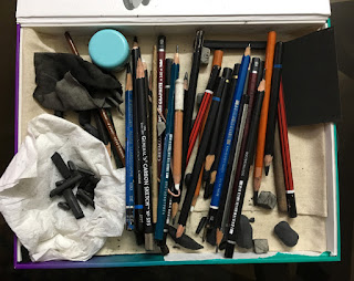 Arranging charcoal drawing tools in a new box by Indian artist Manju Panchal