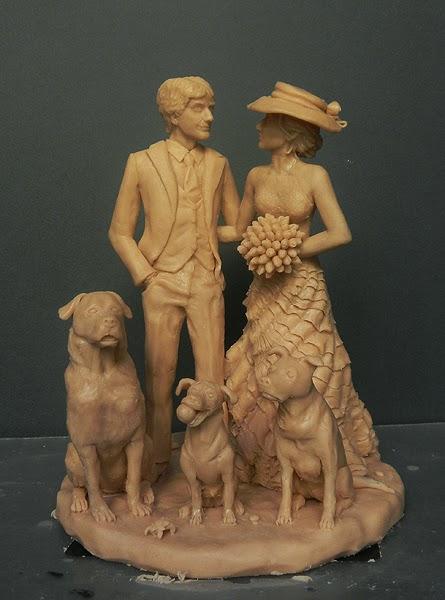 statuine sposi artistiche eleganti artigianali torta nuziale orme magiche