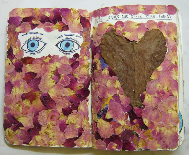 This is another one of my favorite pages. My friend gave me a bunch of flowers, so I dried them out and glued them in my book. I really enjoy using flowers in my work, their colors are beautiful and they can have a very paper-like texture.