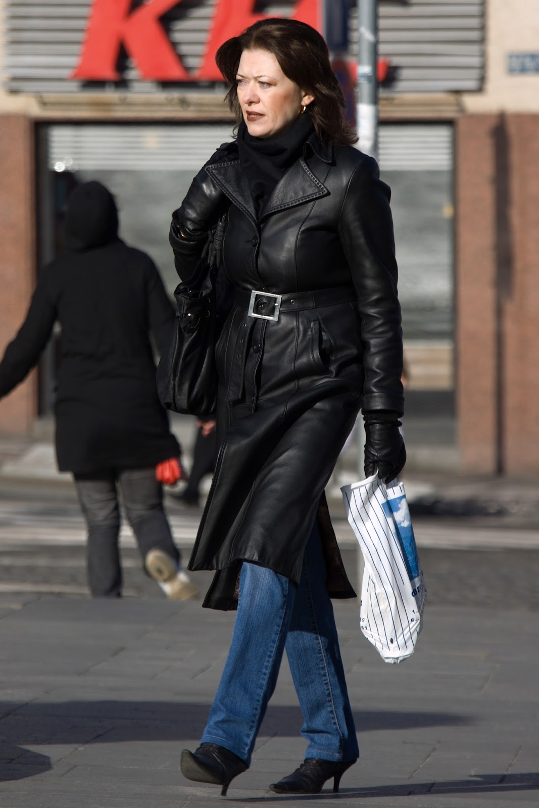 Leather jacket decade - A Pretty Woman In A Leather Coat