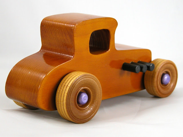 Right Rear -  Wooden Toy Car - Hot Rod Freaky Ford - 27 Coupe - Pine - Amber Shellac - Metallic Purple Hubs