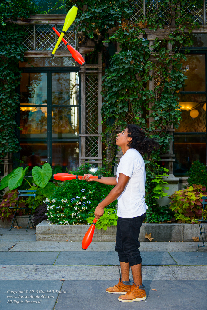 a photo of a juggler in bryant park by daniel south