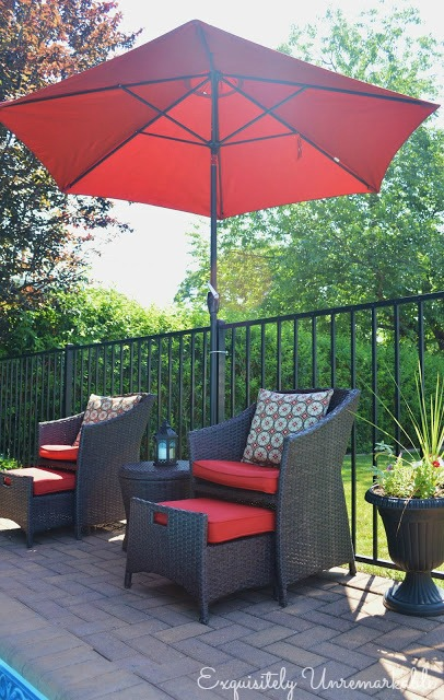 Red Market Umbrella and chairs poolside