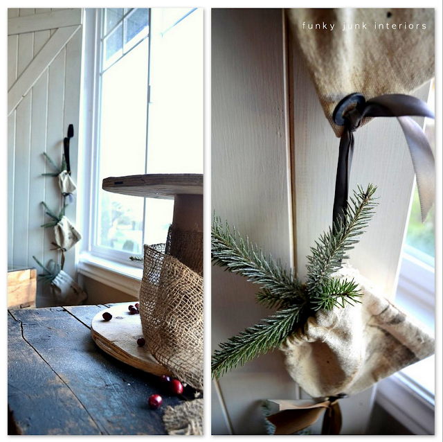 Grain sacks with evergreen branches garland hanging from a door pull as Christmas or winter decorating.