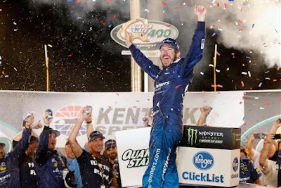 Martin Truex Jr., driver of the #78 Auto-Owners Insurance Toyota, celebrates in Victory Lane after winning the Monster Energy NASCAR Cup Series Quaker State 400 presented by Walmart at Kentucky Speedway on July 14, 2018 in Sparta, Kentucky.