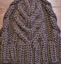 http://www.ravelry.com/patterns/library/november-cabled-hat