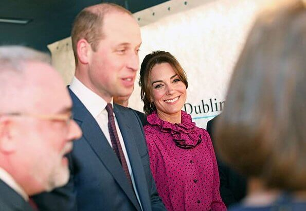 Kate Middleton wore a vintage polka-dot print and ruffle neckline dress by Oscar De La Renta, carried Jimmy Choo Celeste clutch