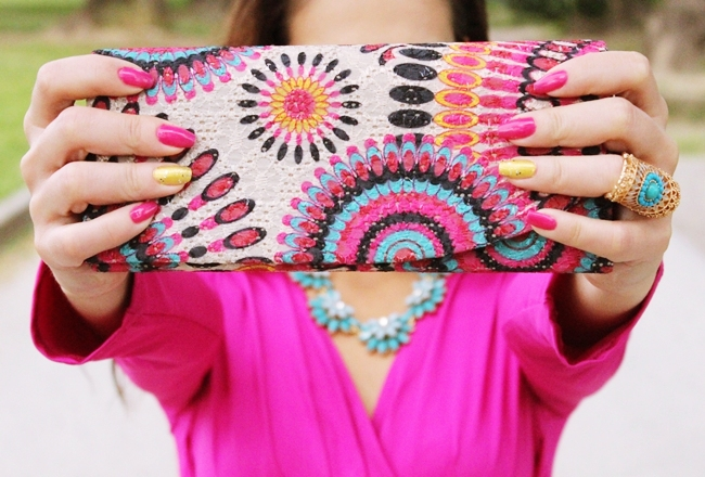 cute printed clutches, pink and yellow nails