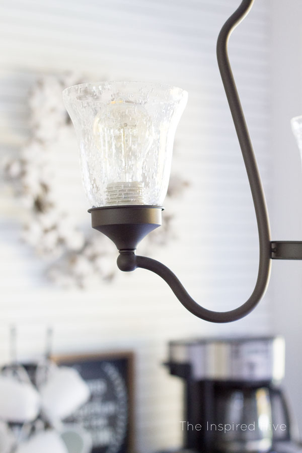 Easy way to update a light fixture! Change the glass shades to fit your decor. Seeded glass and vintage bulbs are perfect for a farmhouse kitchen.