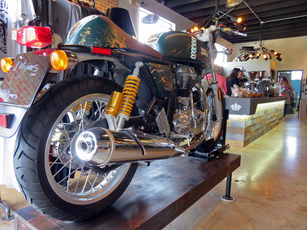 Motorcycle on display in a coffee shop.