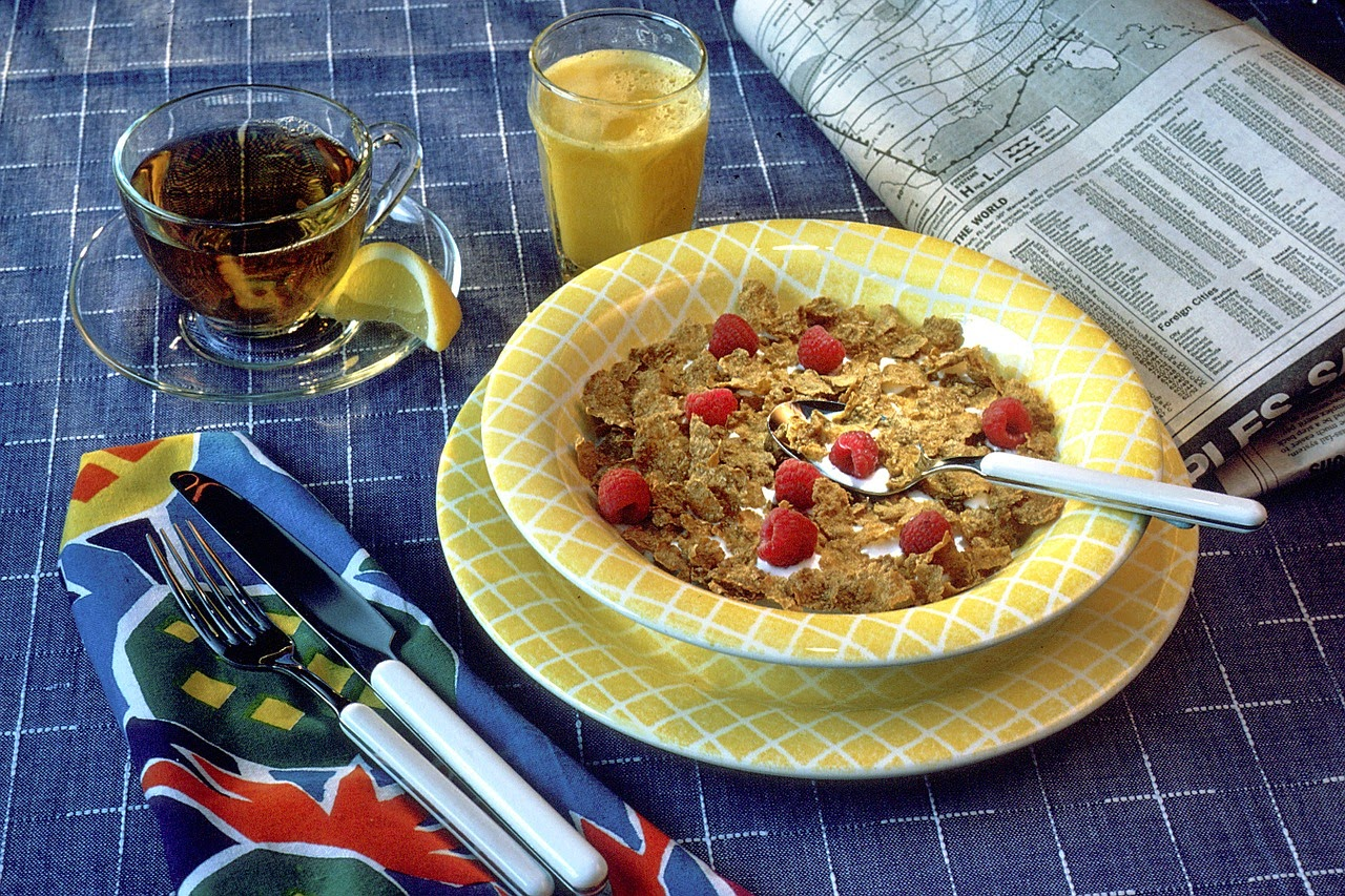 Bowl of cold cereal with raspberries