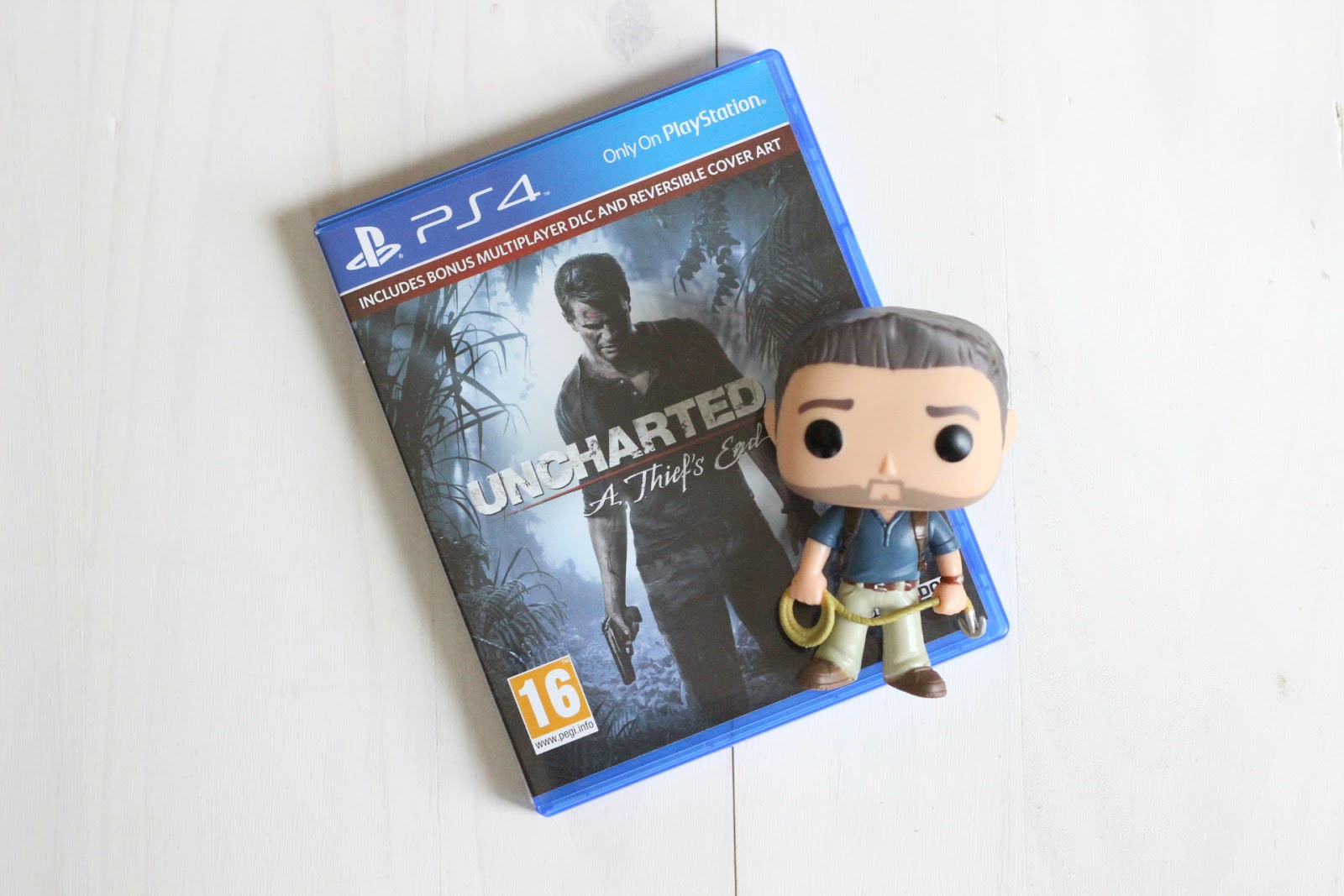 uncharted 4 game and funko pop vinyl
