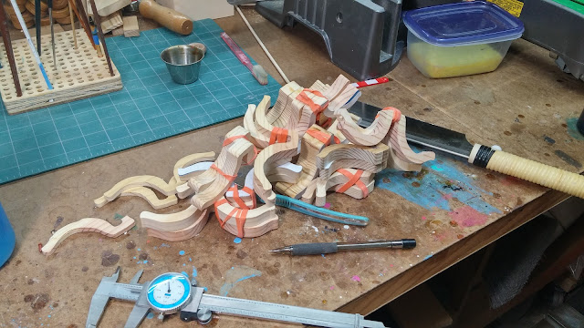 A pile of resawnwooden toy fenders next to my favorite hand saw.