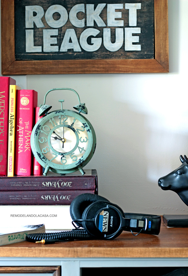 industrial decor in teen boy room - desk with headphones and old clock