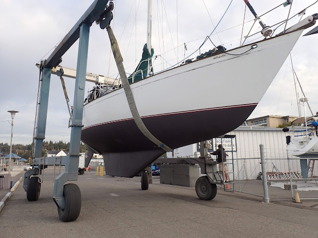 Our sailboat in the travel lift with a freshly painted bottom.