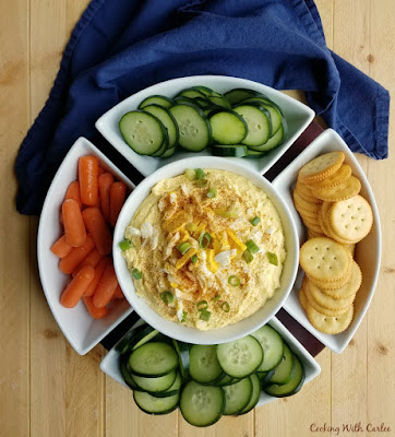 bird's eye of big serving dish with dip, veggies and crackers