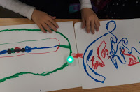 marker code with an Ozobot lit up in Green