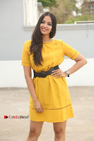 Actress Poojitha Stills in Yellow Short Dress at Darshakudu Movie Teaser Launch .COM 0338.JPG