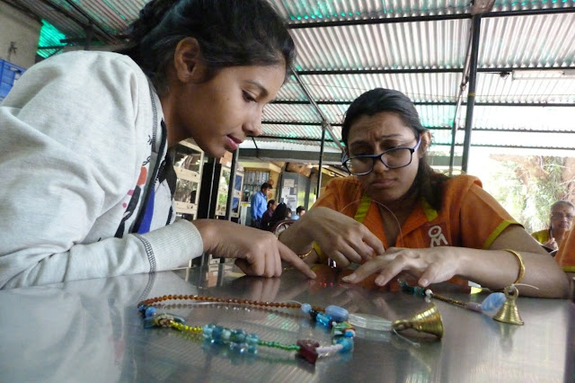 young volunteer help specially-abled in beed work artifact-