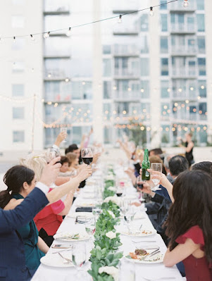 guests at reception table toasting