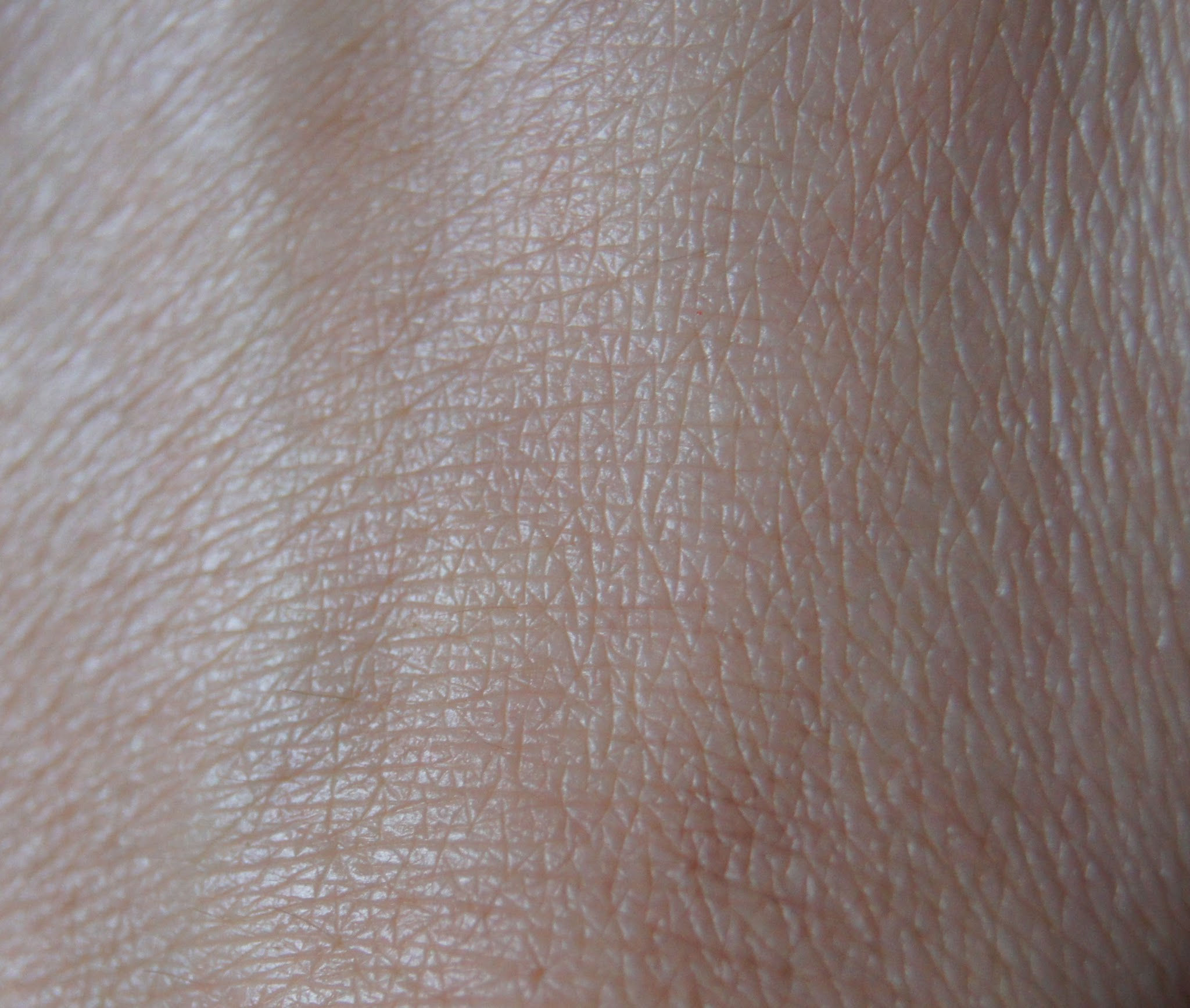 laura mercier oil free tinted moisturizer nude swatch