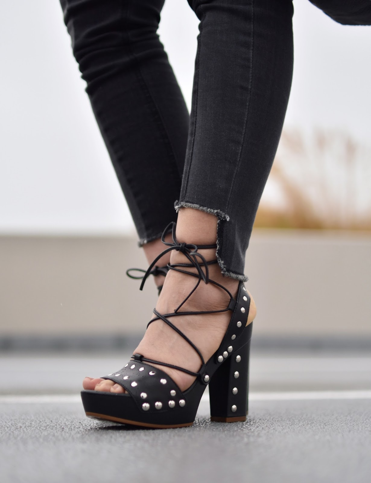 Monika Faulkner outfit inspiration - black step-hemmed jeans, Wishbone Collection lace-up platform sandals