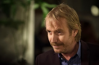 Rhys Ifans as Mycroft Holmes in CBS Elementary Season 2 Episode 8 Blood Is Thicker