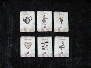 cartas lenormand tetera, niña, lirio, corazón, peces, serpiente