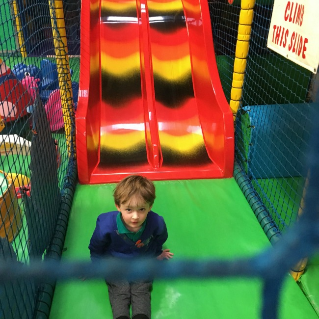 ants-inya-pants-soft-play-cardiff-boy-at-bottom-of-slide