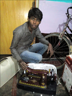Prakash with his sister's sewing machine