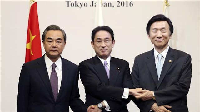 Japan, China and South Korea begin meeting on disputes
