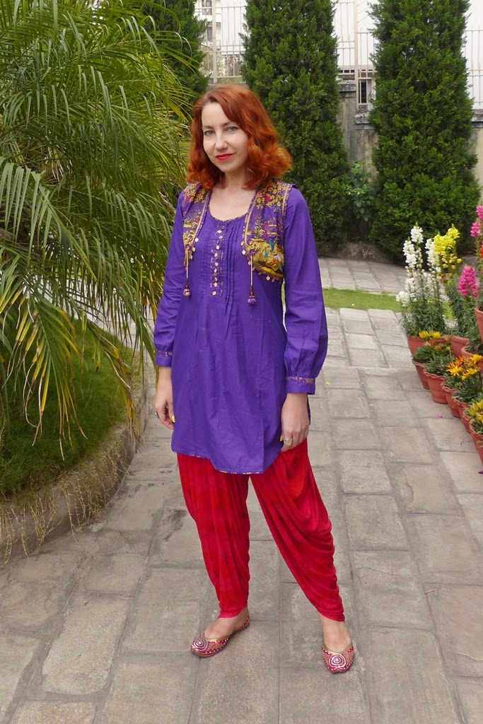 Ethnic Indian outfit: patiala pants, kurta, and printed vest