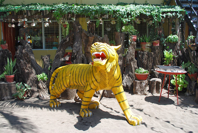 life size tiger sculpture at Villa del Prado beach resort
