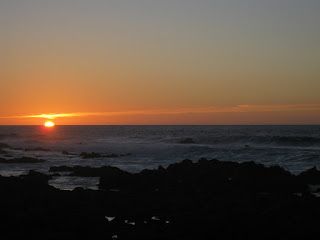 Sun dipping below the horizon at Point Pinos, Pacific Grove, California