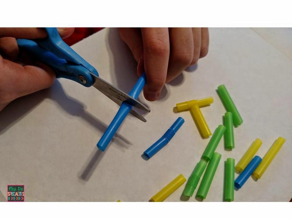 photo of student cutting straws