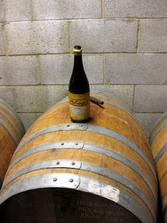 Bottle and barrel of Mckenzie's Saison Vautour.