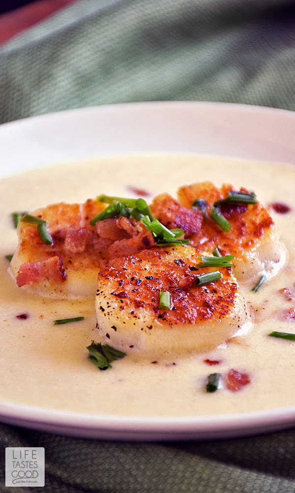 Pan-Seared Scallops with Corn Puree | by Life Tastes Good is a delicious meal that is on the table in about 30 minutes. It is special enough to serve to guests or when you want to enjoy a date night at home. The perfectly seared scallops over creamy corn puree topped off with a little crispy bacon is irresistible!